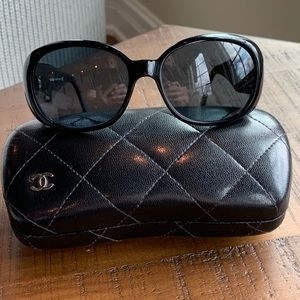 Authentic CHANEL black/white Camellia sunglasses.